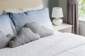 "White bed linen with cloud pillows. Photo by "" khongkitwiriyachan"" FreeDigitalPhotos.net"
