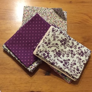 A mixture of fat quarter fabrics.